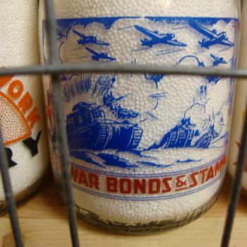 Lots of Tanks & Bomber Airplanes On War Slogan Milk Bottle...... - Bottles