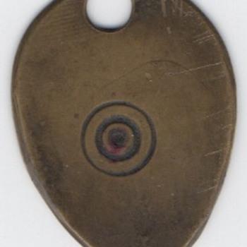 Egg Shaped Gold Colored Bullseye Tag