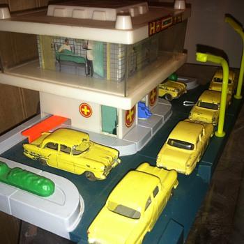 Matchbox cars around a gas station...