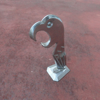 Not sure what this is, I'm guessing that it's some kind of bottle opener - Breweriana