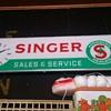 VINTAGE SINGER SEWING CENTER CLOCK.........