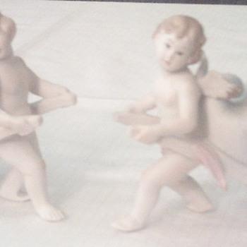 Vintage porcelain Cherub Vases - Pottery