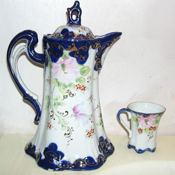 Porcelain Pitcher & 4 cups- What are they for ? where was it made ? - China and Dinnerware