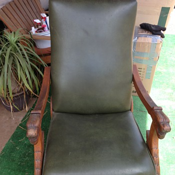 oak rocking recliner chair with lion arms