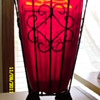 Red glass blown into cast iron wire vase-gargoyl footed