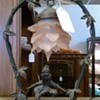 Lamp  with two children or elves playing and glass pink lampshade.
