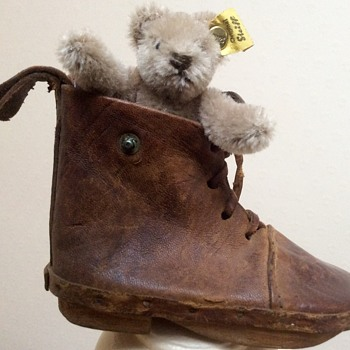Small Steiff teddy in leather shoe? - Dolls
