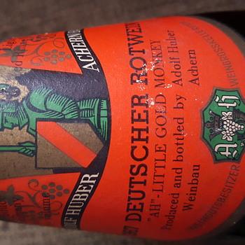 """1967 Deutscher Rotwein """"ah"""" little gold monkey wine bottle"""