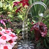 Victorian ruby glass hanging basket on clear stand