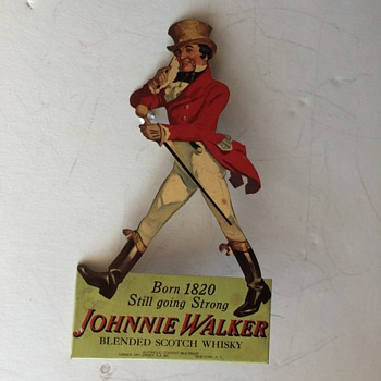 Johnnie walker tin sign