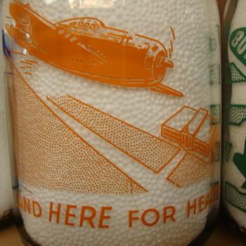"""LAND HERE FOR HEALTH"" War Slogan...Uncommon Design - Bottles"