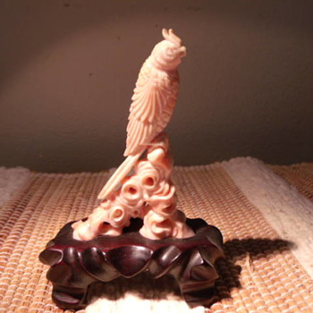 Pink coral carved bird. - Figurines