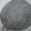 Hieroglyphics on a pendant????