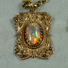 An Early Australian Lightning Ridge Solid Black Opal, in a Traditional 9ct Gold Pendant, by Percy Marks