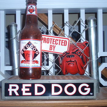 Red Dog beer sign.  Real chain-link fence.  Never saw this before - Signs