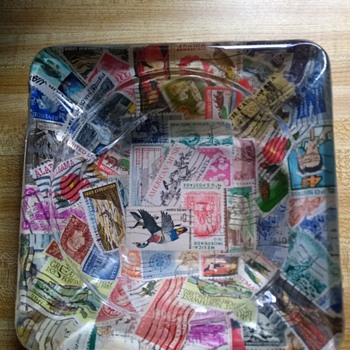 Ashtray with stamp's inside of it. - Stamps