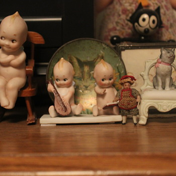 A Modicum of All-Bisque Goebel Kewpies Posing with a Carl Horn Doll and a Seated Pussycat - Dolls