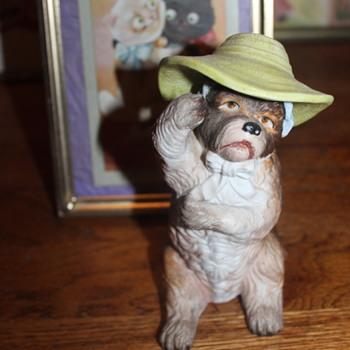 An Anthropomorphic All-Bisque Parlour Dog - Figurines