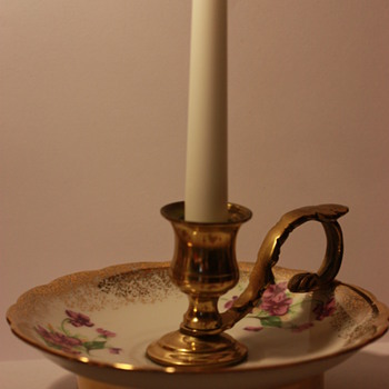 Gold and brass candlestick holder with decal print