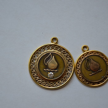 Unusual charm/pendant with a water/flame symbol