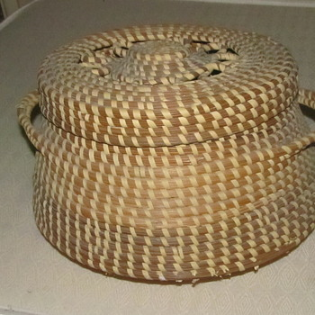 Large woven basket with lid