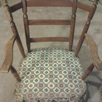 Wing back rocking chair.