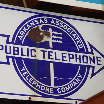 2 Different Arkansas Associated Telephone company signs