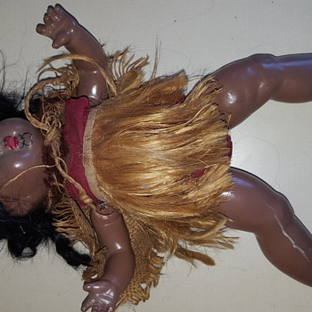 Black doll with chin tattoo