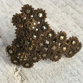 Trying to find antique brass marcasite floral pattern pieces....