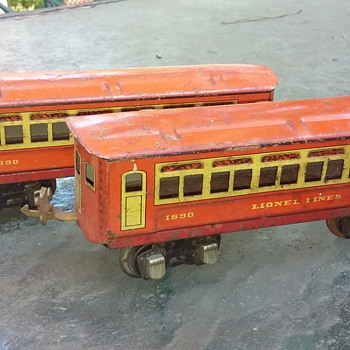 pair of old metal LIONEL model train cars
