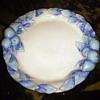 Plate with fruit & blue glaze. No markings.