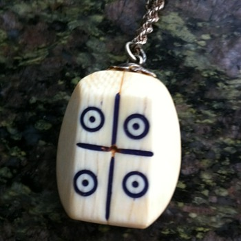 Mystery ivory necklace - game pieces?