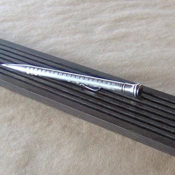 Re-purposed ebony guitar neck pen trays by Mark Weisbeck