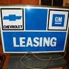 Old Chevrolet GM leasing dealership sign