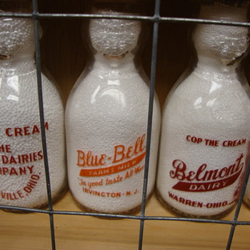 Pint size cop the cream milk bottles...