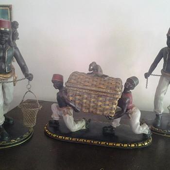 wooden carvings of black coffee pickers  - Figurines