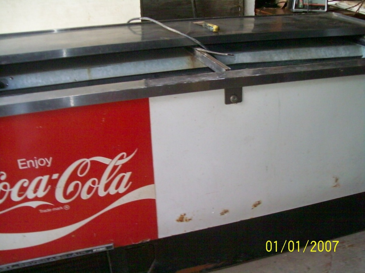 This is an old coca cola beverage cooler made by beverage for 1 door retro coke cooler