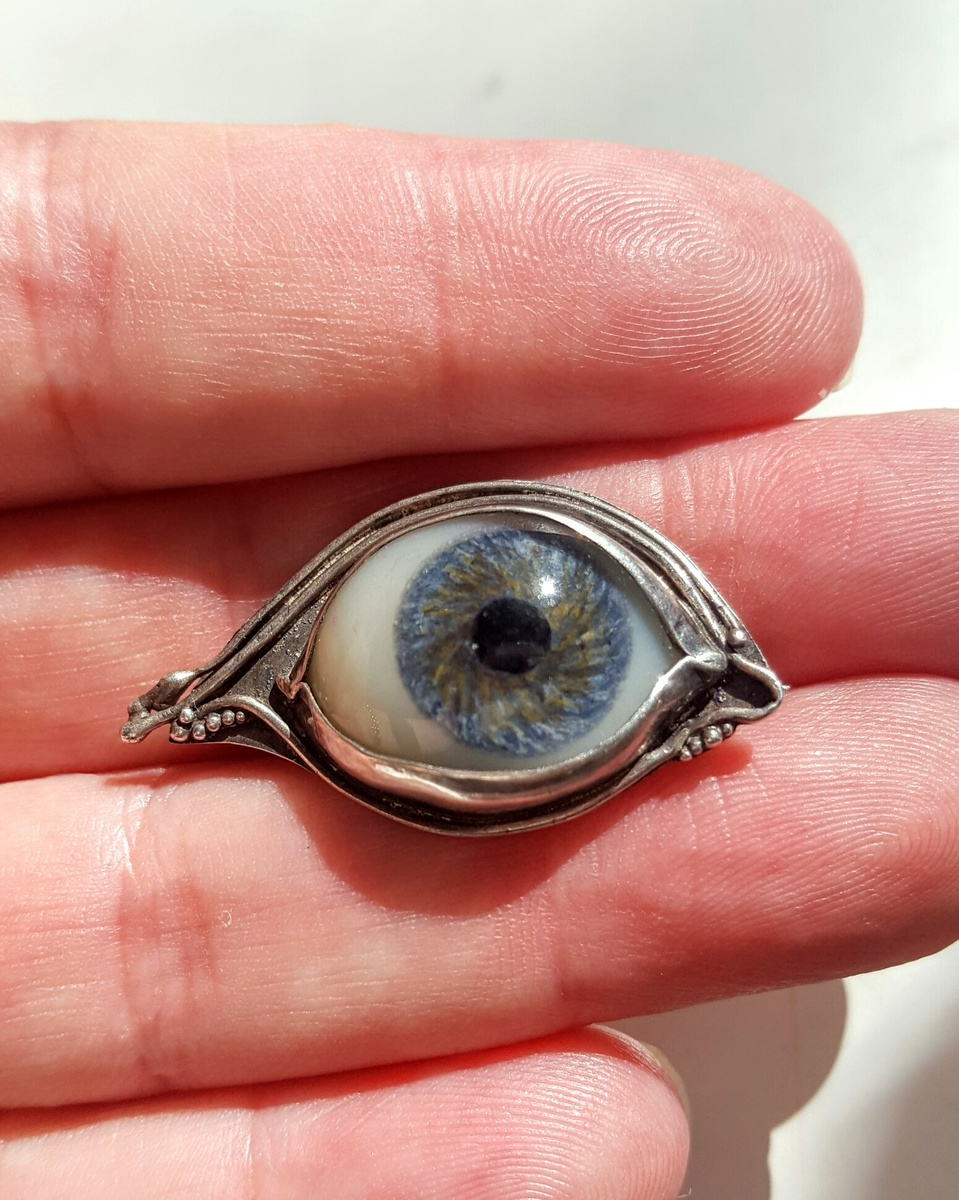 Vintage doll eye brooch