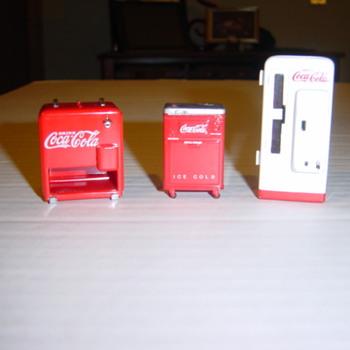 IDing die-cast Coca-Cola machines. - Coca-Cola