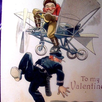 VALENTINE POSTCARD WITH COMIC AIRCRAFT HITTING A POLICEMAN'S HEAD - Postcards