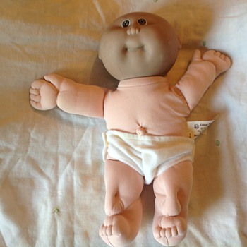 Cabbage patch baby with black head and white body...has anyone else encountered this?