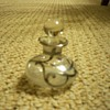 Squat silver overlay perfume bottle