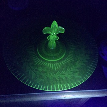 Fostoria serving plate under black light - Glassware