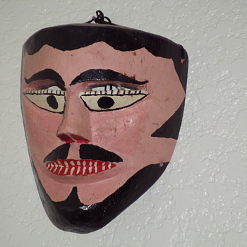 painted wood faces