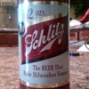 Schlitz flat top steel beer can