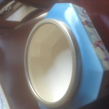 Blue square ceramic bowl with silver rim and Dutch designs.