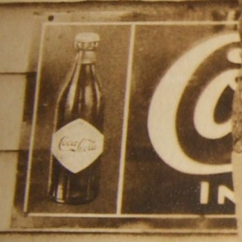 WW1 soldier RPPC in front of Coca Cola sign