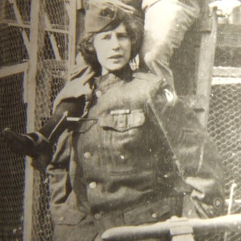 Woman in 3rd Army tunic at pigeon cages!
