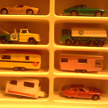 Cars in the display case with plastic curtail removed...To a kid in the 60's, captivating...Kids today...not even a glance! - Model Cars