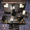 Singer sewing machine in a box with extras.